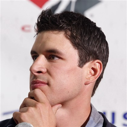 sid1024a-1 Sidney Crosby speaks to reporters at the Canadian national men's team orientation camp in Calgary in August.