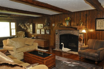 Great room at Franklin Park The great room features a wood-burning fireplace and wood beams taken from the century-old barn on the property.