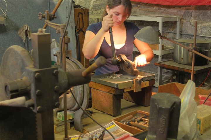 "Chloe Darke Chloe Darke works at Old Newbury Crafters in Amesbury, Mass., in PBSs ""Craft in America: Forge."""