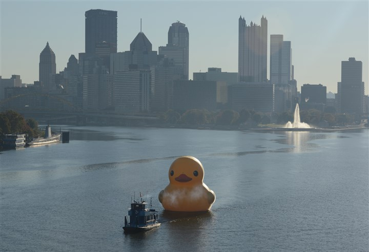 Ds1021Loc3DuckyLeaves.jpg An ALCOSAN towboat heads on the Ohio River with the Rubber Duck in tow, leaving the Pittsburgh skyline behind.