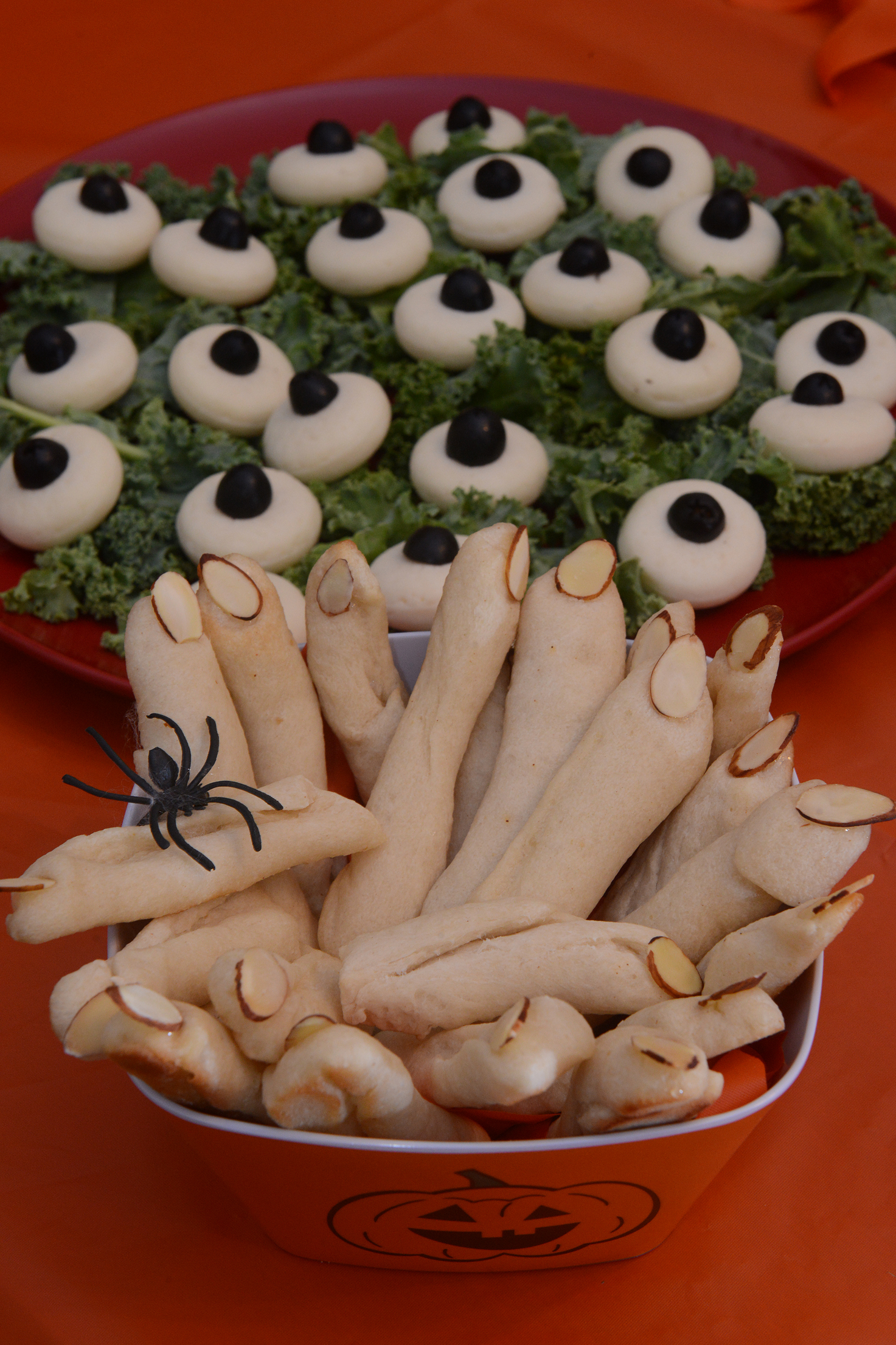 Gnarly fingers Gnarly fingers made of Pillsbury bread sticks and slivered almonds, front, and eyeballs made of Baby Bella cheese and sliced olives .