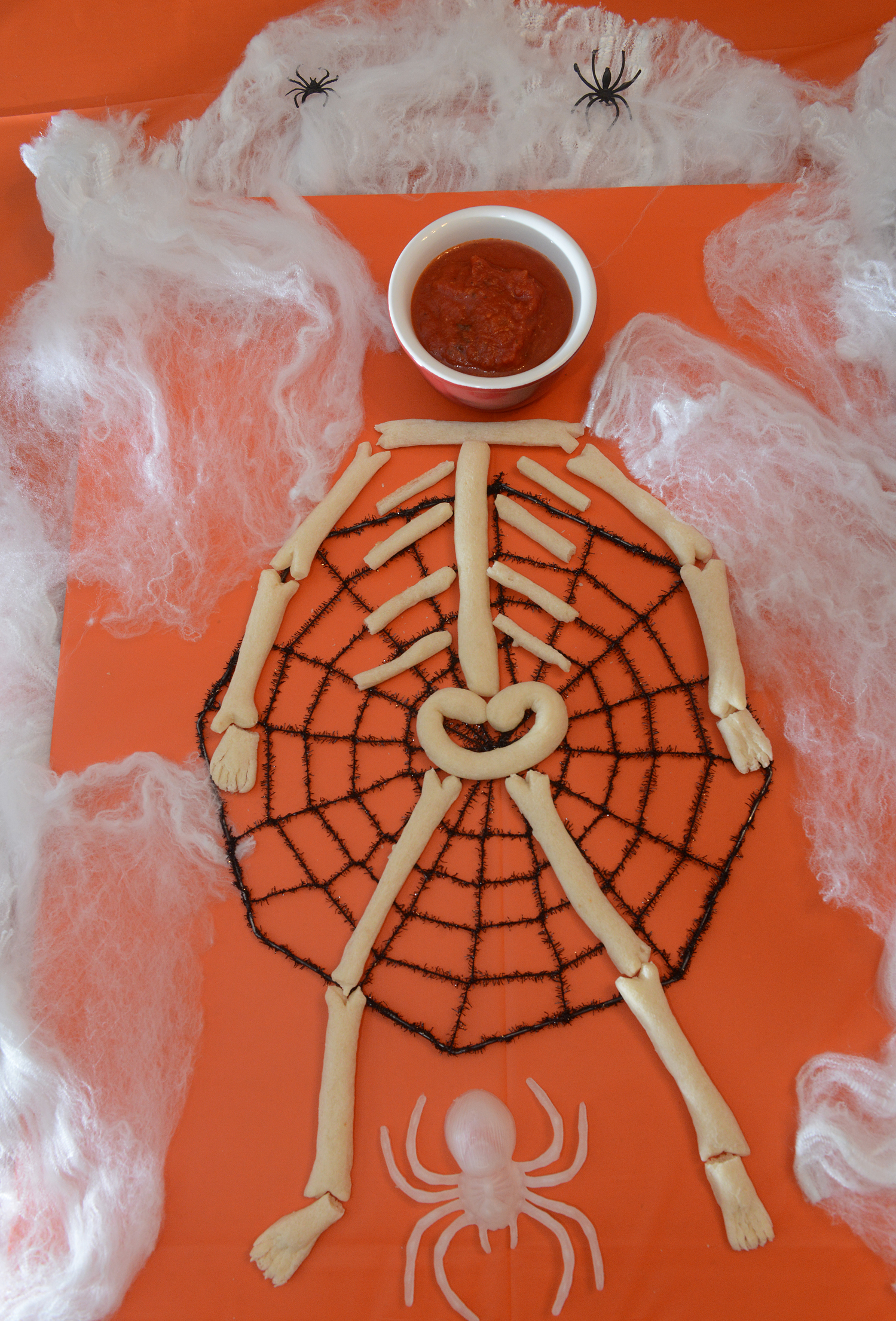 Skeleton Bread stick skeleton with marinara sauce. FOOD