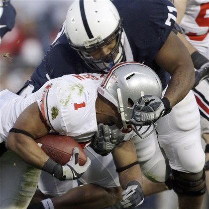 psu1025a Penn State defensive lineman Devon Still takes down Ohio State running back Dan Herron in 2009.