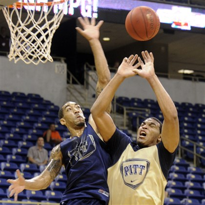 pittbb1025a Cameron Wright blocks a shot by Derrick Randall during the Blue and Gold scrimmage Oct. 7 at Peterson Events Center. Wright is ready to take on more responsibility for the Panthers this season.