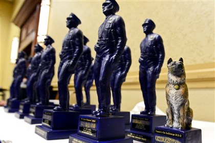 Special Award at Amen Corner A canine statue sits in line Friday with other awards at the Amen Corner's 13th Annual Sen. John Heinz Law Enforcement Awards Day. The German shepherd-shaped award was presented to Steelers quarterback Ben Roethlisberger in appreciation of his contribution to the Police Canine Program.