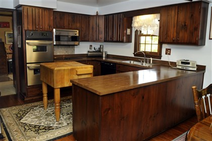 The kitchen at Franklin Park the eat-in kitchen is a combination of stainless steel and traditional wood cabinets that offer plenty of storage.