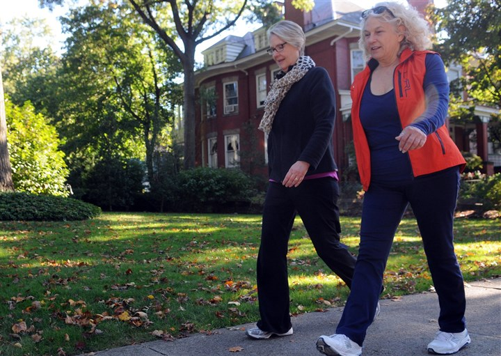Walking Vicki McElroy and Marty Stahl start on their walk through Shadyside along Westminster Place.