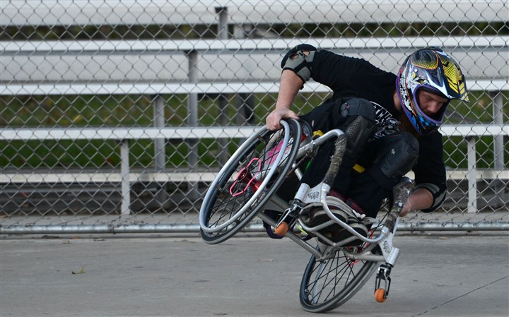 20131024MHwheelchairHealth0.5-2 Jonathan Stark does wheelchair motocross, also known as WCMX, an emerging sport that uses wheelchairs like a BMX bike or skateboard. Here, Stark, 23, practices WCMX at a skate park in Boyce Park.