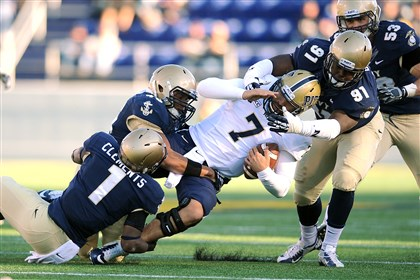 FBCPitt3Navy13-3 Navy's Brendon Clements, Chris Johnson and Aaron Davis stop Pitt quarterback Tom Savage Saturday in the fourth quarter of the Panthers' 24-21 loss to the Midshipmen.