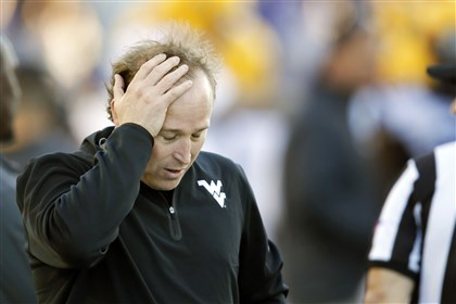 holgorsen1027-1 WVU coach Dana Holgorsen holds his head during the second half of last Saturday's 35-12 loss at Kansas State.