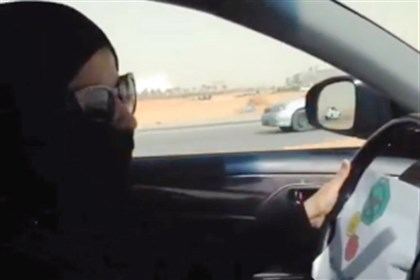 SaudiWomen In this video image, a Saudi woman drives to the grocery store Saturday in Riyadh.