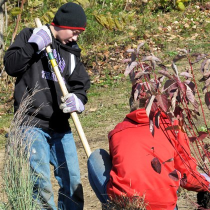 Pantelis Nick Pantelis, 14, left, and Thomas Becker, 15, both ninth-graders at Baldwin High School, plant little bluestem ornamental grass Saturday during the installation of a tiered rain garden and observation deck .