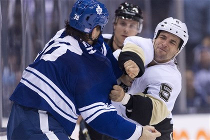Maple Leafs Frazer McLaren, left, fights against Deryk Engelland Maple Leafs Frazer McLaren, left, fights against Deryk Engelland, right, during the first period Saturday night in Toronto.