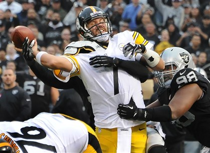 20131027pdSteelersSports05 Ben Roethlisberger is pressured in Sunday's game by the Raiders' Lamarr Houston late in the fourth quarter in Oakland.