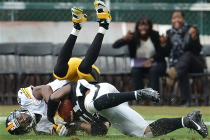 Steelers Raiders cornerback Mike Jenkins intercepts pass from Steelers quarterback Ben Roethlisberger late in the fourth quarter of Sunday's loss that dropped the Steelers to 2-5.