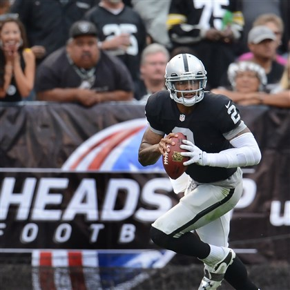 cook1028 Raiders quarterback Terrelle Pryor rolls out to pass against the Steelers in the third quarter Sunday.