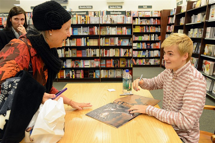 "20131027radJackGleesonMag02-3 ""This is for my son-in-law. Can you say something horrible?"" asks Shelia Herbermann as actor Jack Gleeson, Joffrey Baratheon in ""Game of Thrones,"" prepares to autograph her Game of Thrones picture book during his appearance at Barnes & Noble at the Waterfront in Homestead Sunday."
