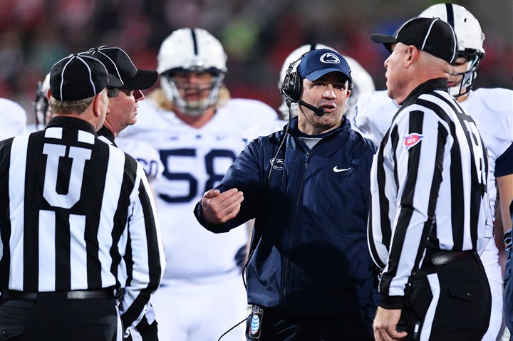 psu1028-2 Head Coach Bill O'Brien of the Penn State Nittany Lions discusses a call with officials in the third quarter against the Ohio State Buckeyes at Ohio Stadium on Saturday. Ohio State defeated Penn State 63-14.