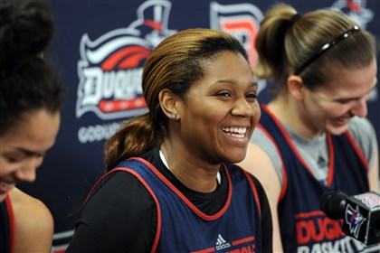 20131028dukessports2-1 Duquesne's Wumi Agunbiade discusses her team's upcoming season Monday.