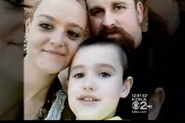 20131028firevictims.jpg This photo shows Lisa Hewitt, 28, and her 5-year-old son, Timothy, who both died in a fire in their home in Buffalo, Washington County. Timothy Hewitt Sr., at right, was not home at the time.