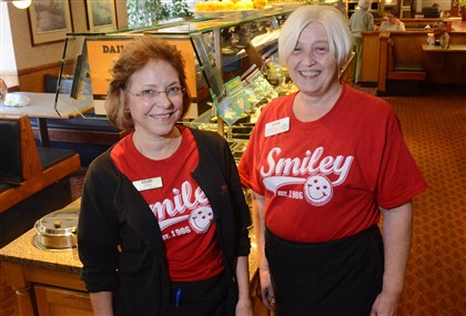 20131028MHeatnparkMagazine01 Debby Bottoroff, left, and Bonnie Palashoff pose for a portrait at the Eat'n Park on Banksville Road, where the two have worked for 35 and 30 years, respectively.