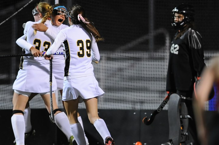 hsfield1030 North Allegheny's Jessica Brandon (33) is congratulated by Bree Monnin and Maddy Snyder (39) after scoring against Fox Chapel Tuesday night.