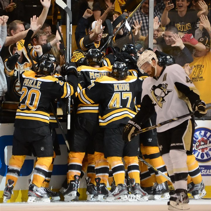 pens1030e-2 The Bruins celebrate a winning goal by Patrice Bergeron in last year's conference final.