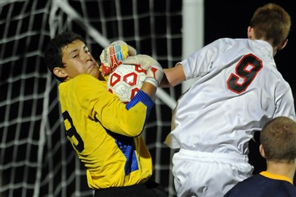 Central soccer Central Catholic goalkeeper Oscar Marroquin makes a save on Upper St. Clair's Joel Hart in the regular-season finale for both teams.