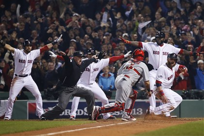 series1031k-6 St. Louis Cardinals catcher Yadier Molina looks back as home-plate umpire Jim Joyce calls Boston Red Sox's Jonny Gomes safe on a three-run double by Shane Victorino in the third inning of Game 6 of the World Series Wednesday night at Fenway Park in Boston.