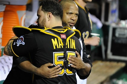 Russell Martin embraces Francisco Liriano  Russell Martin embraces Francisco Liriano after Liriano was removed from the Pirates' National League wild-card victory against Cincinnati. The two free agents were key pieces of the Pirates' resurgence throughout the season.