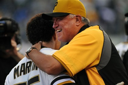 A hug from the manager for walk-off hero Russell Martin. A hug from the manager for walk-off hero Russell Martin.