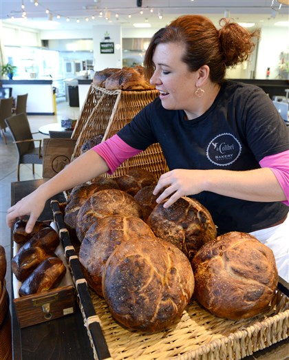 Trimble Beth Trimble arranges breads at Marty's Market in the Strip District.