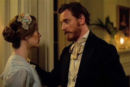 "12years2 Sarah Paulson as Mistress Epps and Michael Fassbender as Edwin Epps in ""12 Years a Slave."""