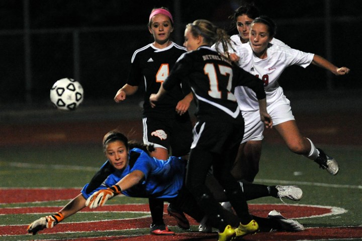 Peters Soccer Peters Township goalkeeper Megan Parker makes a save, denying Bethel Park's Tatiana Ruzzini, left, and Hayley Hulbert, right.