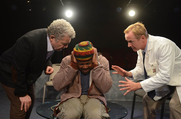 "OrangeWeekend Sam Tsoutsouvas, left, and David Whalen, right, portray doctors with differing opinions on the treatment of a mental patient, played by Rico Parker, in Phoenix Theatre's debut production, ""Blue/Orange."""