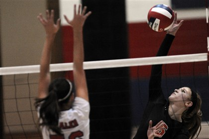hsgirlsvolleyrp1101 Shaler's Annie Bozzo, left, defends against Bethel Park's Morgan Stelmaszynski.