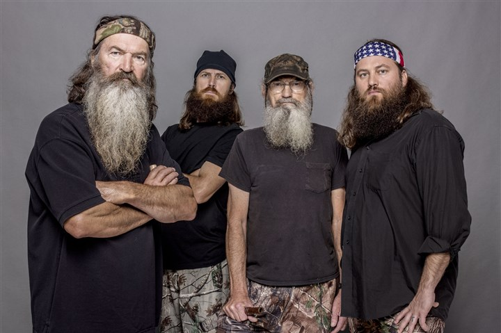 "DuckDynasty_group_122813 The A&E Network has reinstated the suspended Phil Robertson, left, of ""Duck Dynasty,"" who won't miss any filming of the popular TV series."
