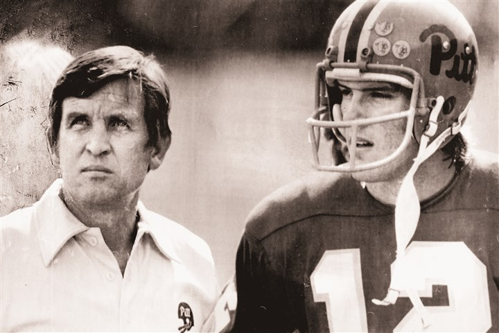 cavanaugh1101 Former Pitt quarterback Matt Cavanaugh talks with his coach Johnny Majors.