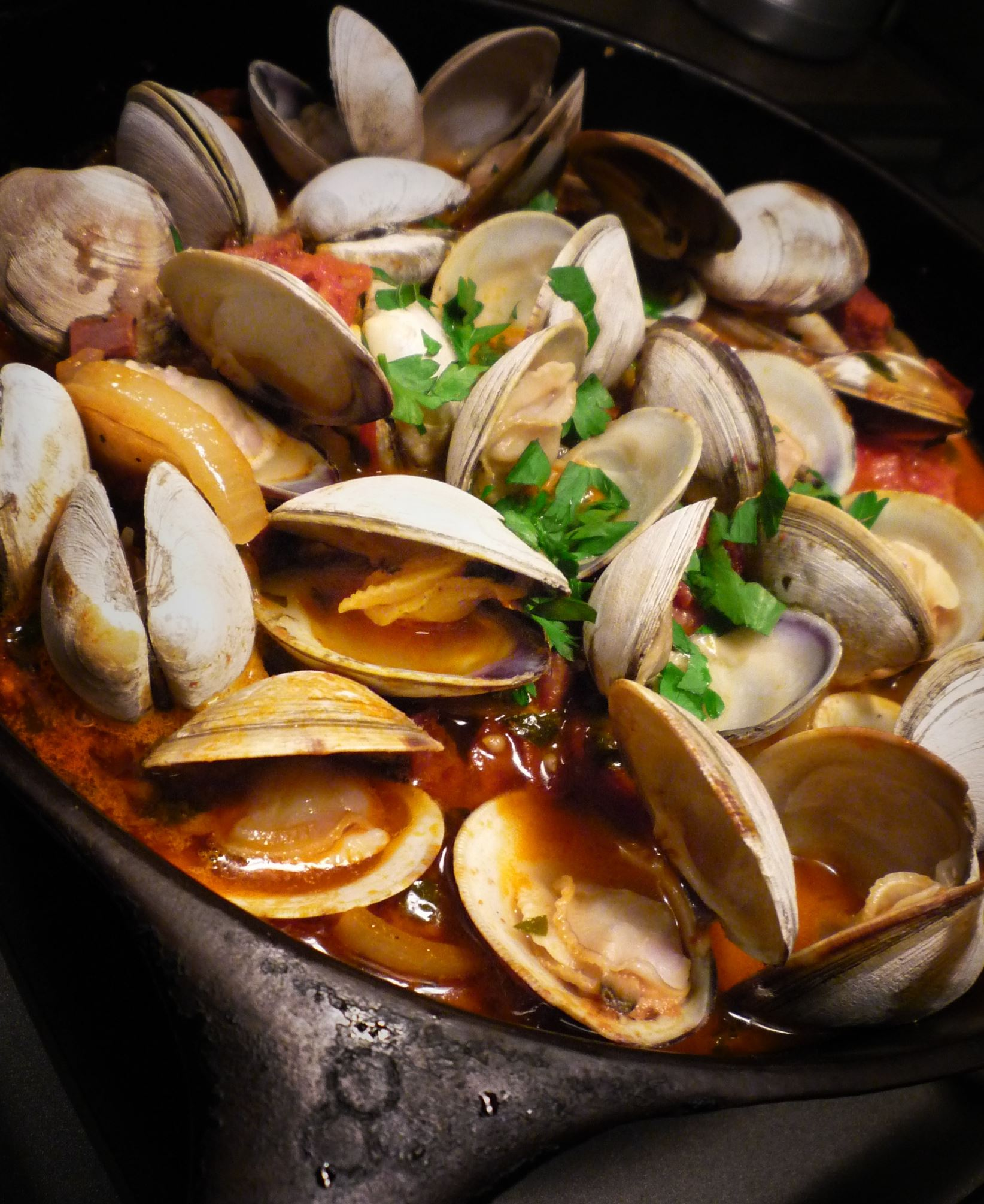 Clams Clams with Sausage, Ham and Spices, a recipe from Portugal that is delicious over rice.