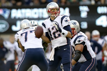 gene0119 Patriots quarterback Tom Brady looks to pass in a game against the Jets earlier this season.