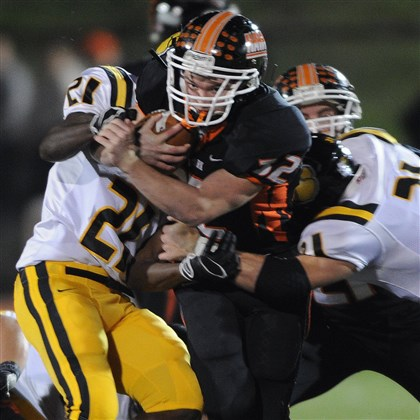 Bethel Park's Alex Minton  Bethel Park's Alex Minton carries the ball Friday against North Allegheny in the second quarter at Black Hawk Stadium.