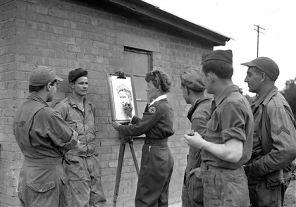 "Black1944 Elizabeth Black sketches troops in England in 1944. She traveled with a Red Cross Clubmobile in the field. Every soldier's picture was mailed home for him. ""I love this work,"" she said, ""and I don't mind how many critics look on."""
