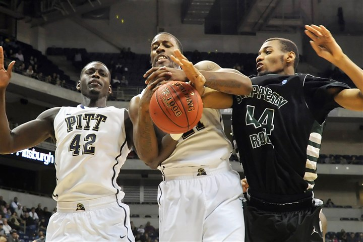 20131101mfPittSports06-5 Matt Freed /Post-Gazette November 1, 2013 Pitt's Talib Zanna and Lamar Patterson reach for a rebound against Slippery Rock's Eric Raleigh in the second half at Petersen Events Center Friday night.