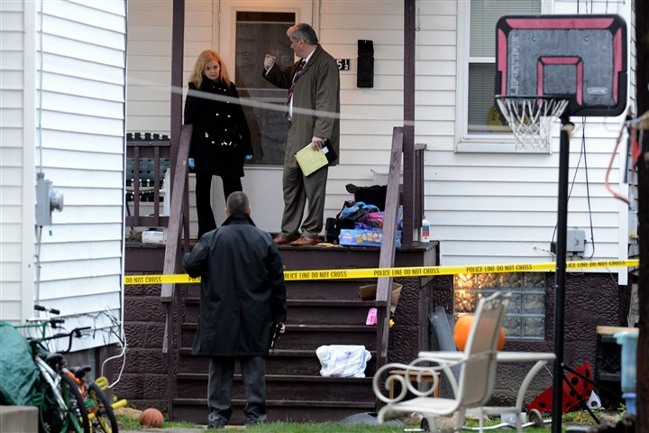 Fatal Shooting in Coraopolis 2 Police investigators at the scene of the shooting death in Coraopolis.
