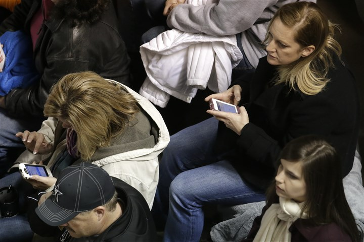 20131103 sports fans wifi Fans use their cell phones during an NCAA college football game between Vanderbilt and Tennessee in Nashville, Tenn.