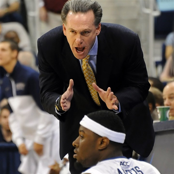 pittbb1216 Pitt coach Jamie Dixon talks with Jamel Artis, one of several freshmen embracing his role for the Panthers.