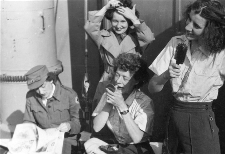 Blackarchive1 Red Cross members taken onboard a ship during WWII. The lady applying lipstick is Elizabeth Black.