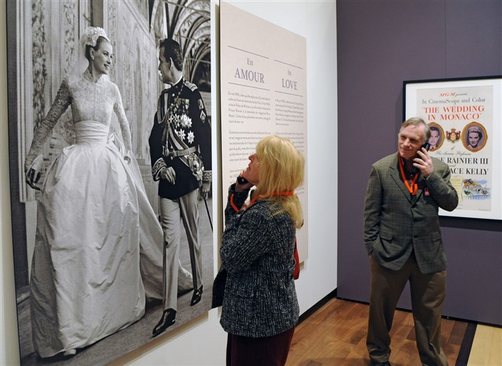 PrincessGrace6 Jim, 51, and Ellen, 49, Melson of Carversville, PA, listen to the audio tour of the Princess Grace Kelly exhibit at the James Michener Museum.