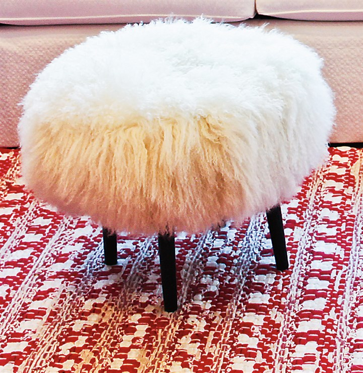 furry Wesley Hall's Mongolian lamb stools patterned after a turn of the century 3 legged milking stool.