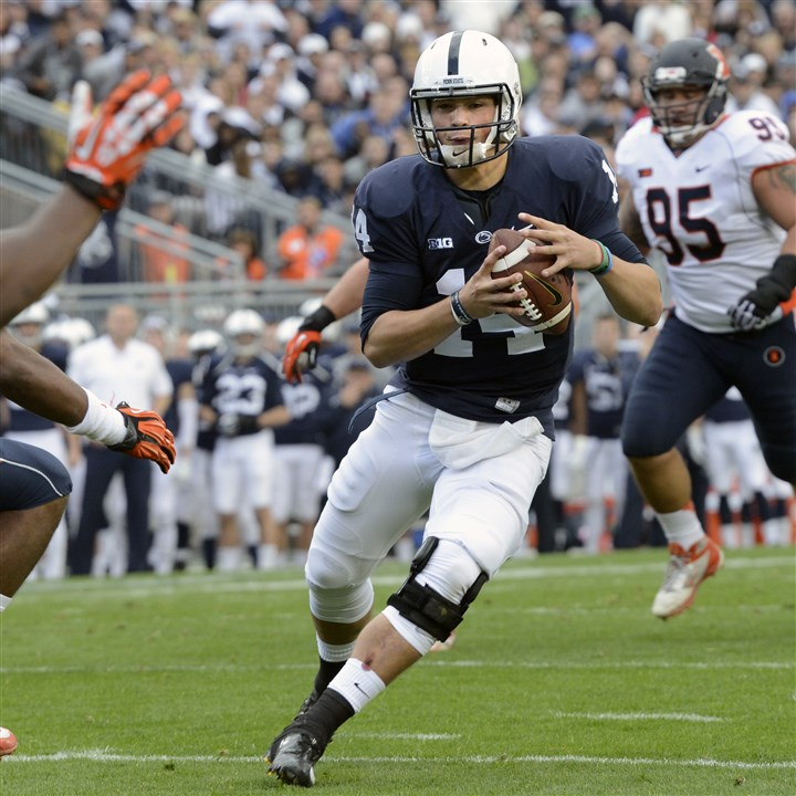 Penn State quarterback Christian Hackenberg  Penn State quarterback Christian Hackenberg scores on a 9-yard run in the second quarter of an NCAA college football game against Illinois in State College, Pa., Saturday, Nov. 2, 2013.